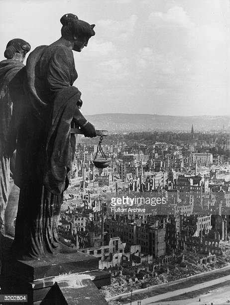 Highangle view of the bombed remains of Dresden after Allied bombings seen from the top of a tall building possibly a courthouse where a statue of a...