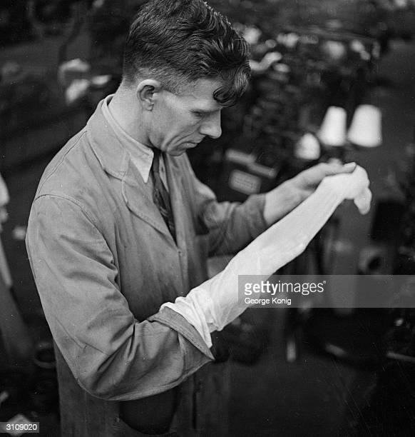 Mr J Prunell a former ICI chemist who specialises in nylon dye examines a stocking at the Ballite Hosiery Mills St Albans