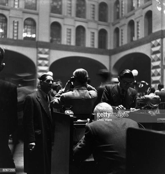Milan's bankers conduct their business on the Milan Stock Exchange from individual booths marked with their names