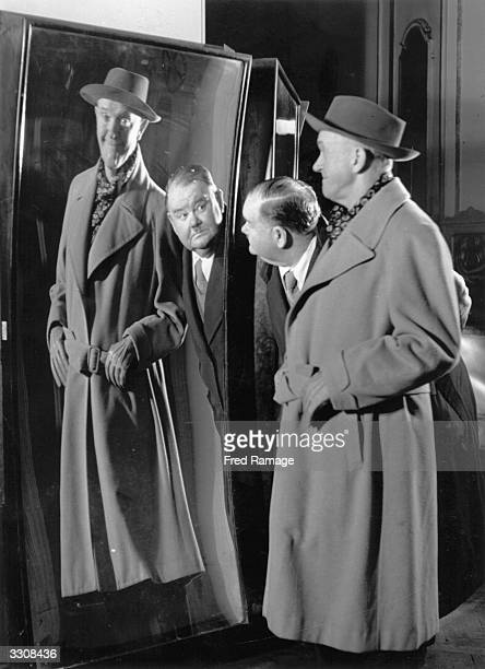 Oliver Hardy is dismayed to see his partner Stan Laurel is, for once, the bigger of the pair, in a distorting mirror at Madame Tussaud's.