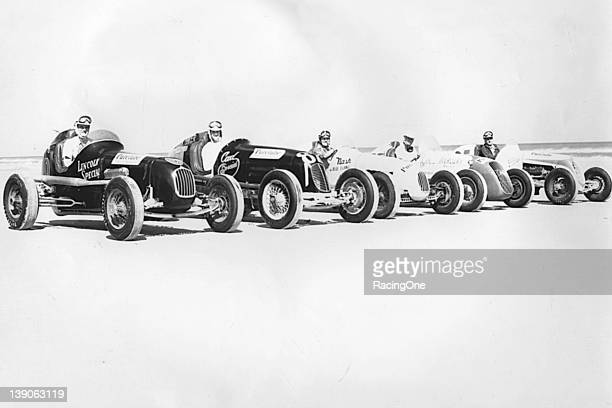 """Five of the 11 NASCAR Speedway Division drivers who showed up at the Daytona BeachRoad Course for special """"practice"""" runs pose with their cars The..."""