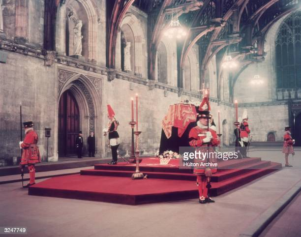 The body of King George VI lying in state in Westminster Hall London before being taken to St George's Chapel Windsor for burial The coffin is...