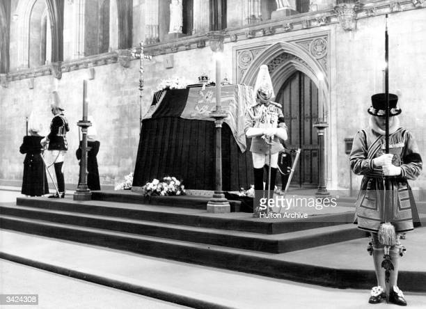 The coffin of King George VI of Great Britain at Westminster Hall guarded by Horse Guards and Beefeaters.