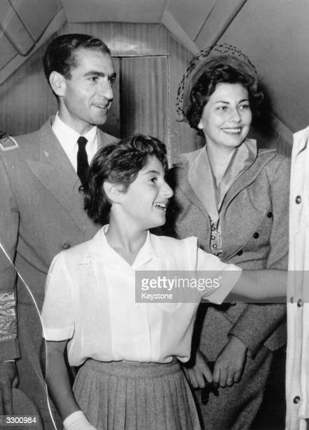 Mohammed Reza Pahlavi Shah of Iran with his wife Soraya Queen of Persia and daughter Princess Shahnaz at the airport at Tehran bound for Switzerland...