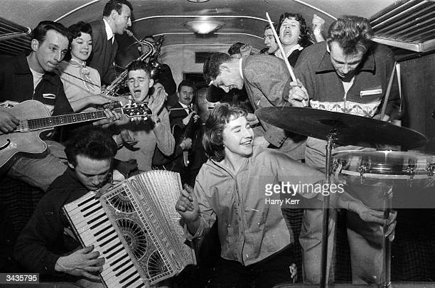 Bill Haley's band The Comets play in the cramped space of a railway carriage en route to London