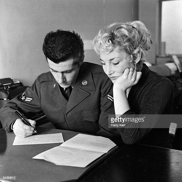 Margaret Halton and Brent Bowen begin the lengthy process of form-filling which will enable them to get married and live in America together....