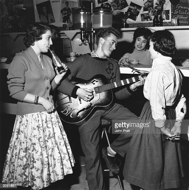 Singer and guitarist Bill Kent entertains some teenage fans in 'The Two I's Coffee Bar' in Soho