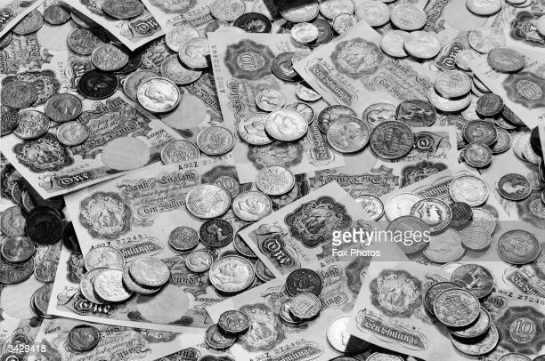 The heartwarming sight of a pile of English one pound and ten shilling notes scattered with various coins