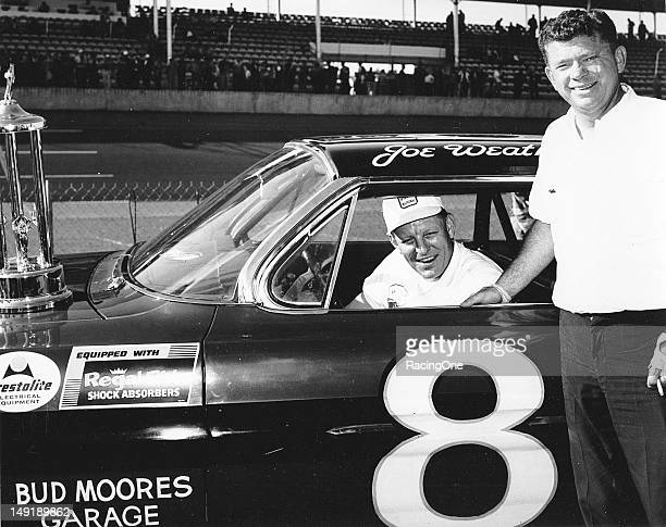 February 1962: Car owner Bud Moore and his driver Joe Weatherly display their trophy after Weatherly won the second qualifying race that set the...