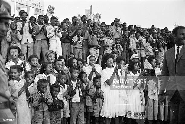 Crowds in Addis Ababa applauding Queen Elizabeth II and Prince Philip at the start of their tour of Ethiopia