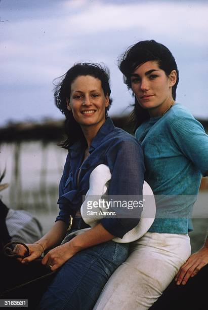 Minnie Cushing shares a horse with author and photographer Caterine Milinaire in Acapulco