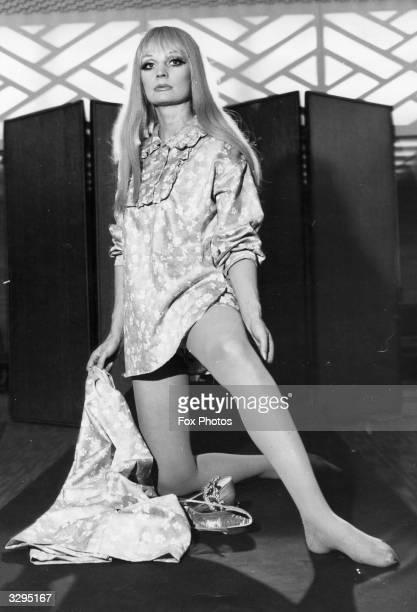 Model Hannerle Dehn models 'Hostess' a pyjama suit by Hardy Amies from his range of Bonsoir pyjamas for women in London 'Hostess' is a threepiece...