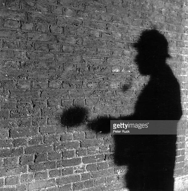 The shadow of R A Rendel, publicity manager for the Abbey National Building Society, in the guise of fictional detective Sherlock Holmes. Mr Rendel...