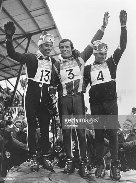 The three Giant Slalom champions celebrating their success at the 1968 Winter Olympics from left to right Willy Favre who came second the winner...