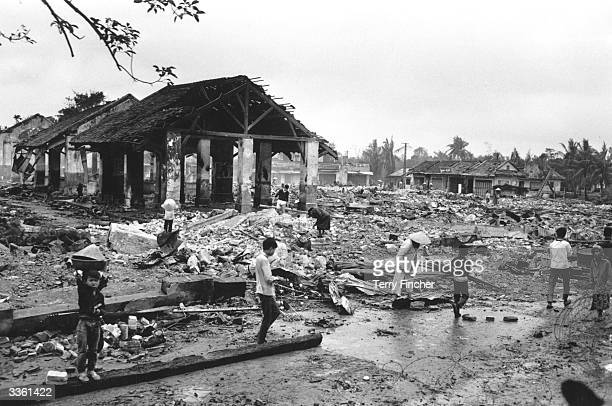 Vietnamese refugees returning to the war torn city of Hue