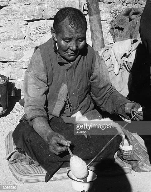 A Tibetan refugee at a camp in Dalhousie northern India spinning wool by hand Since fleeing across the Tibetan border from the invading Chinese...