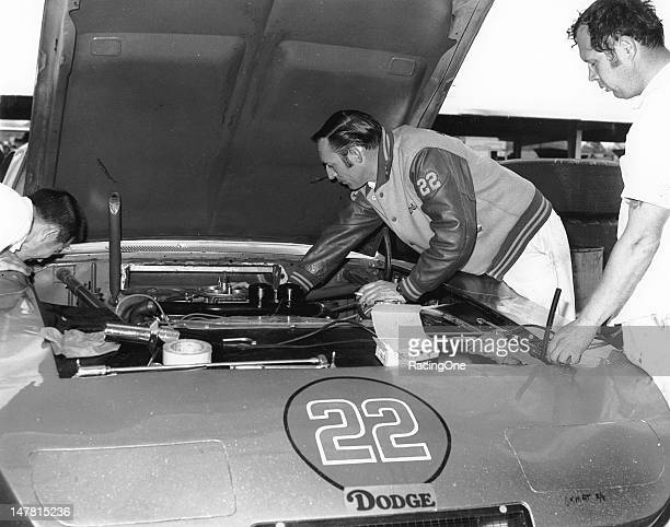 Car owner Mario Rossi and mechanic Eddie Allison work on the engine of the Dodge Charger Daytona to be driven in the Daytona 500 NASCAR Cup race by...
