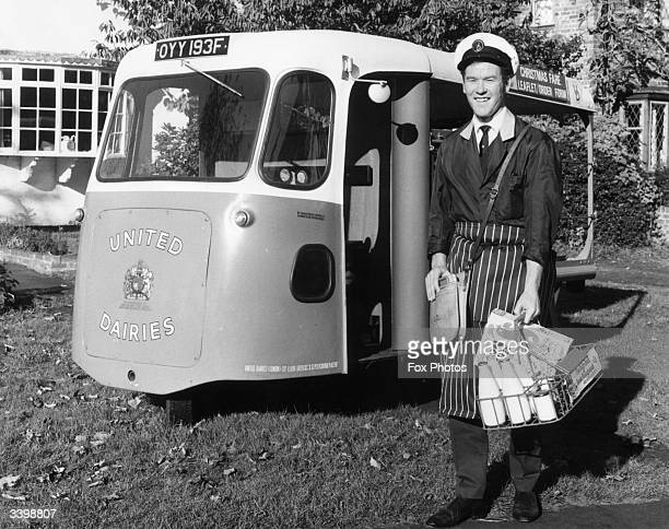 A milkman with his electric milk delivery float