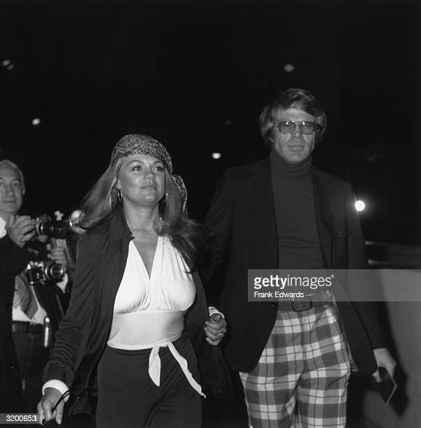 American actor Dyan Cannon and her date Ron Travis arrive at the premiere of director Mel Stuart's documentary film 'Wattstax' Hollywood California...