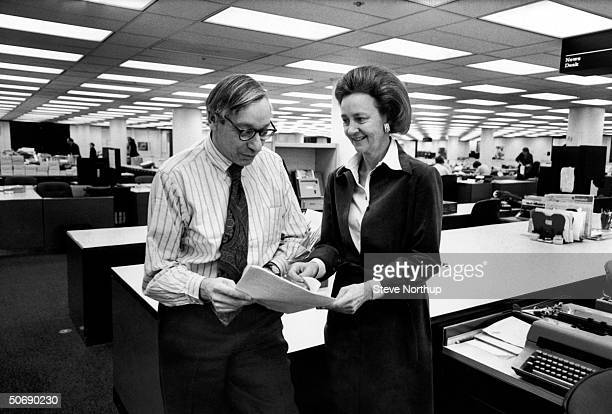 Washington Post publisher Katharine Graham chatting w managing editor Howard Simmons in the newsroom