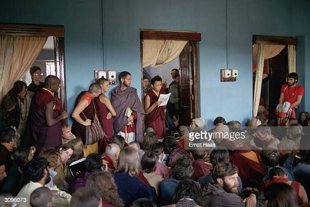 Important points of the Kalachakra Initiation Ceremony spoken by the Dalai Lama are translated to western pilgrims and Buddhist monks by an English...