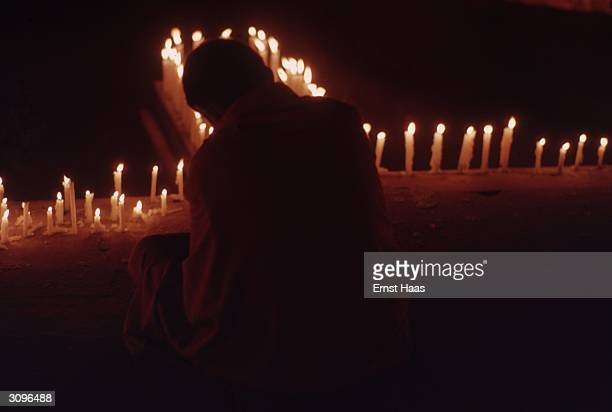 Lighting candles during the Kalachakra Initiation Ceremony held in Bodhgaya in the state of Bihar in north-eastern India.