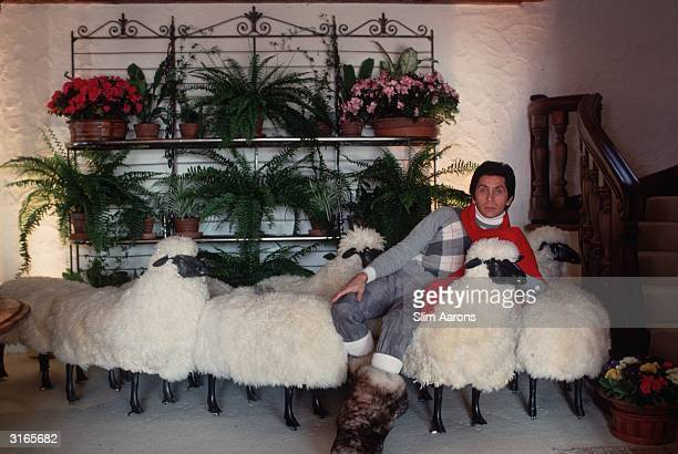 In a chalet in the ski resort of Gstaad, dress designer Valentino relaxes on a sofa made of sheep. He started in the trade working for Desses and...