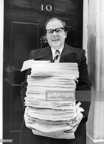Andrew Bowden MP struggles under the weight of 250000 signatures outside 10 Downing Street London The petition organised by the National...
