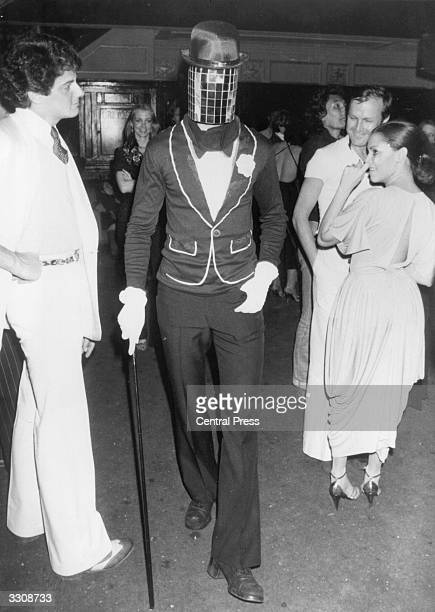 A man in costume with a mirror mask at New York's Studio 54 disco