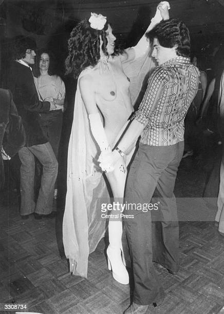 A semiclad girl and a young man dancing at New York's Studio 54 disco
