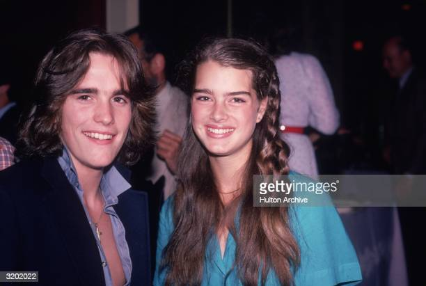American actors Matt Dillon and Brooke Shields smile for photographers at Dillon's sixteenth birthday party February 1980 Dillon has feathered hair...