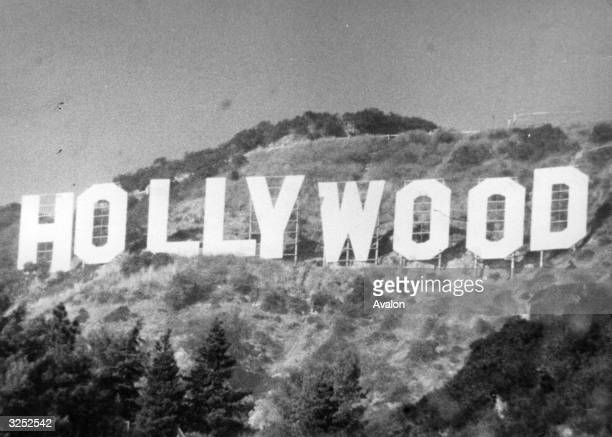 The large sign set in the hills on the outskirts of the film city of Hollywood in California