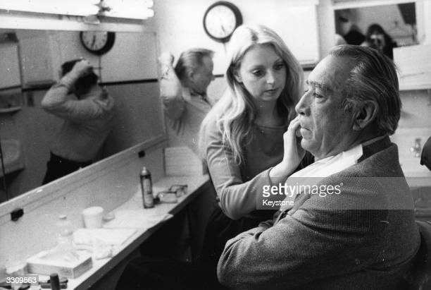 Veteran actor Anthony Quinn being made up for his role in the new film 'Lion of the Desert' by makeup artist Candy Correll