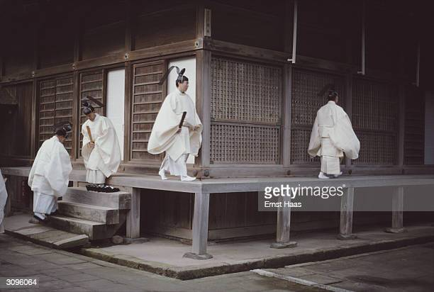 Shinto priests at the Izumo temple in Japan The temple houses a shrine dedicated to OkuninushinoMikoto a Shinto deity who is believed to have ruled...