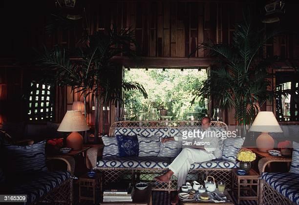 Dress designer Oscar De La Renta relaxes in the living room of his apartment the Casa de Madera in the resort of Casa de Campo in the Dominican...