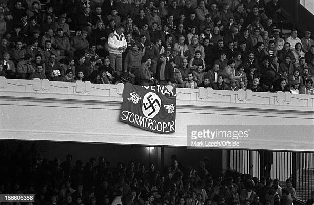 08 February 1987 Arsenal v Tottenham Hotspur Football League Cup a highly offensive banner with a swastika is draped over the parapet of the East...