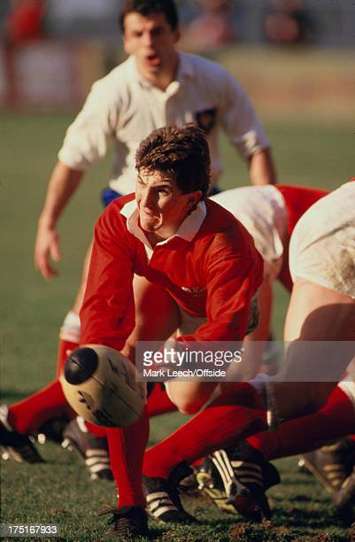 February 1987 Paris - 5 Nations Rugby - France v Wales, Welsh scrum half Robert Jones passes the ball from the scrummage.