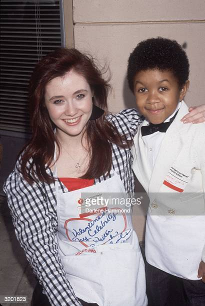 American actors Shannen Doherty and Emmanuel Lewis smile for photographers at a Velentine's Day Celebrity Waiter brunch at Cyril's benefiting the...