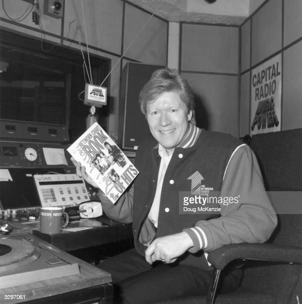 Canadian born disc jockey David 'Kid' Jensen, whilst working at London's Capital Radio.