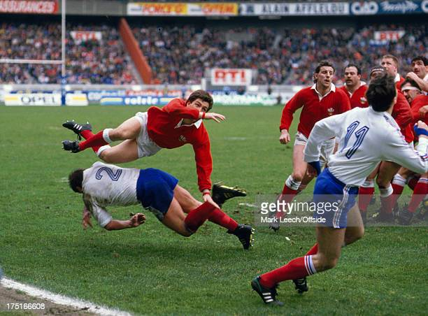 February 1989 Paris - 5 Nations Rugby - France v Wales, Welsh scrum half Robert Jones clears the ball as French hooker Philippe Dintrans dives to try...