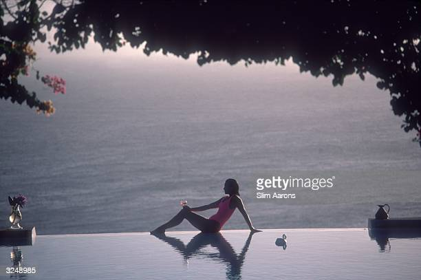 'Town Country' writer Meg O'Neil relaxes by the pool on the island of Mustique in the Grenadines