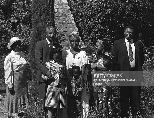 Former South African President Nelson Mandela with his wife Winnie MadikizelaMandela and the Mandela family at Bishops Court one day after his...