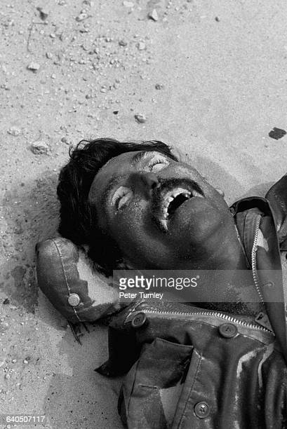 A few days after the end of the Gulf ground war an Iraqi soldier lays in the desert near where his convoy of vehicules was bombed and strafed by...