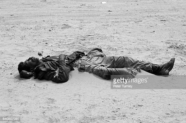 Sand begins to cover the corpse of this Iraqi soldier in a northern Kuwaiti desert