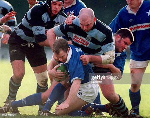 February 1999; Conor McGuinness, St Marys, in action against John Hayes and Alan Quinlan, Shannon. AIB League Rugby, St. Mary's College v Shannon,...
