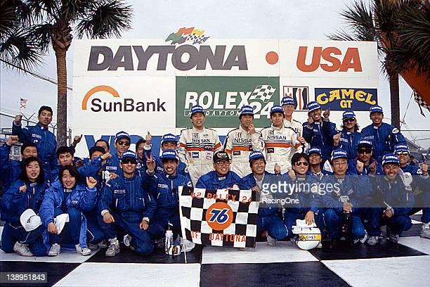 At Daytona International Speedway winning drivers Masahiro Hasemi Kazuyoshi Hoshino and Toshio Suzuki are joined by the entire Nissan Motorsports...