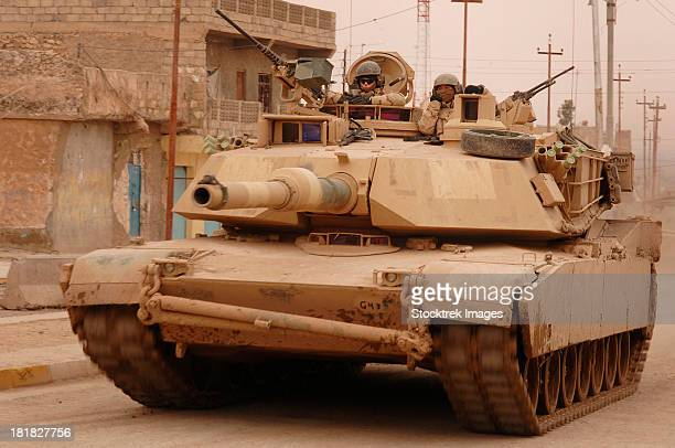 february 2, 2006 - u.s. army m1 abrams tank conducts a combat patrol in tall afar, iraq.   - m1 abrams stock pictures, royalty-free photos & images