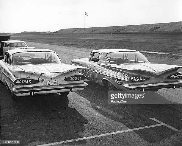 A pair of Chevrolet Impalas sit on pit road at Daytona International Speedway awaiting the start of the NASCAR Cup qualifying race for the first...