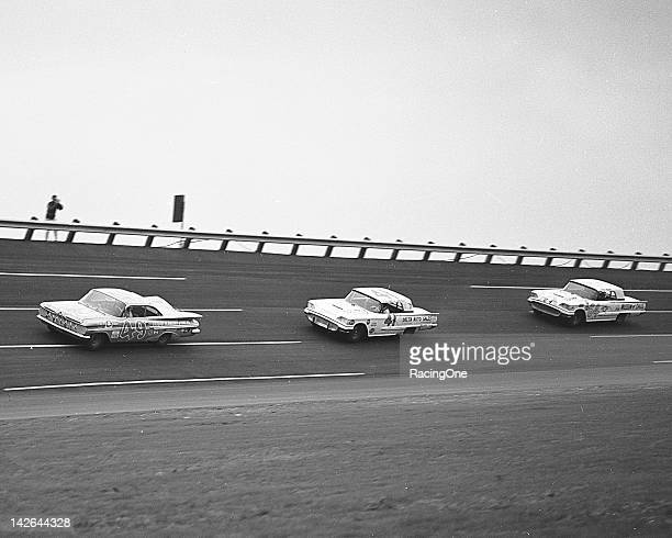 Action during the NASCAR Cupstyle qualifying race for the first Daytona 500 at Daytona International Speedway has Bob Welborn in a 1959 Chevrolet...