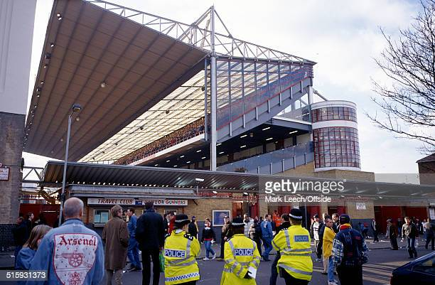 26 February 2000 Premier League Football Arsenal v Southampton fans in the North Bank at Highbury stand in respect of the recently deceased Stanley...